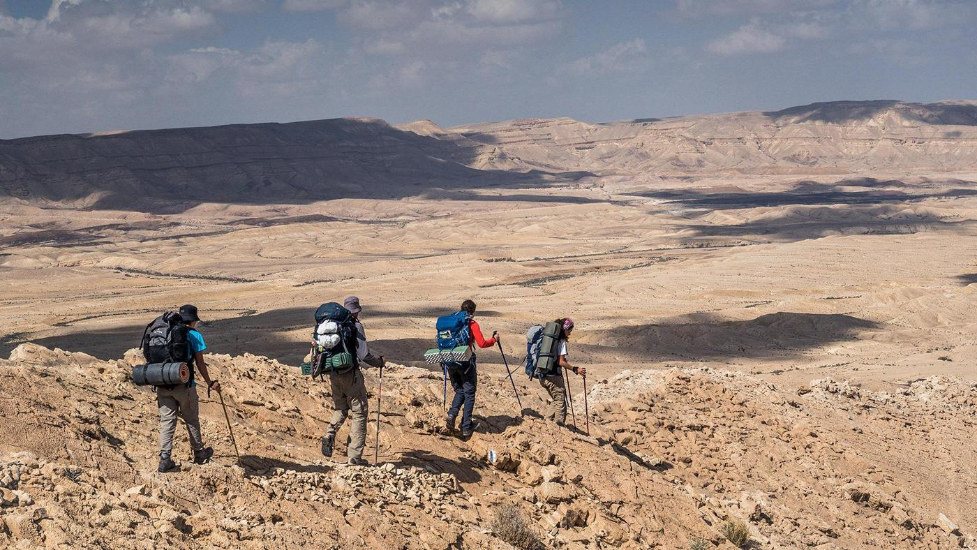 Hiking Negev desert without caching water. Food, water and supplies on Israel National Trail